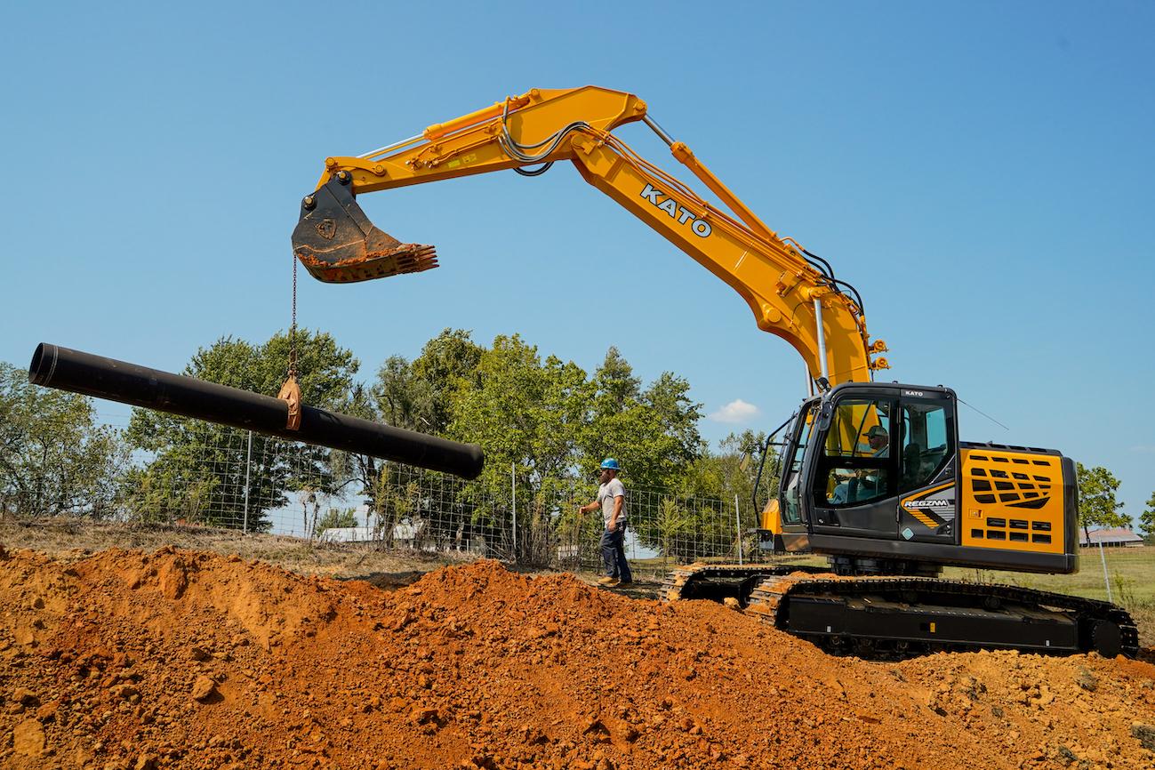 Kato excavator with pipe